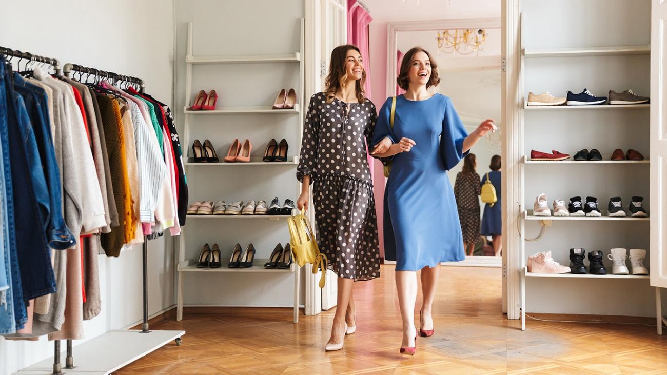 Two pretty young women shopaholics